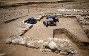 Workers pray inside the remains of a mosque discovered by the Israel Antiquities Authority and which they say is one of the world's oldest mosques, in the outskirts of the Bedouin town of Rahat in southern Israel July 18, 2019. Reuters