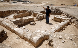 An archaeologist gestures as he stands inside the remains of a mosque discovered by the Israel Antiquities Authority and which they say is one of the world's oldest mosques, in the outskirts of the Bedouin town of Rahat in southern Israel July 18, 2019. Reuters