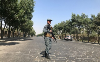 An Afghan policeman keeps watch at the site of a blast near Kabul University in Kabul, Afghanistan July 19, 2019. REUTERS