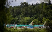 FILE -- Boeing 737 Max airplanes at the Renton Municipal Airport near Boeing's factory in Renton, Wash., May 15, 2019. Boeing said on Thursday, July 18, 2019, that it would take a $5.6 billion charge in the quarter as it reels from the prolonged grounding of its 737 Max. (Lindsey Wasson/The New York Times)
