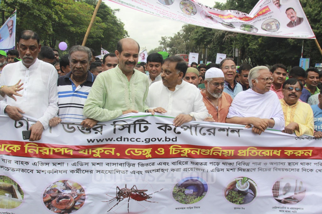 Dhaka North Mayor Atiqul Islam and Home Minister Asaduzzaman Khan Kamal among participants of a procession took out by the city corporation on Manik Miah Avenue on Friday to raise awareness among the citizens about mosquito-borne disease dengue. Photo: Mahmud Zaman Ovi