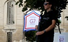 A Gendarme stands guard during the G7 finance ministers and central bank governors meeting in Chantilly, near Paris, France, July 18, 2019. Reuters