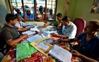 FILE PHOTO - People wait to check their names on the draft list at the National Register of Citizens (NRC) centre at a village in Nagaon district, Assam state, India, July 30, 2018. REUTERS