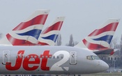 File Photo: A Jet2 aircraft taxis past British Airways aircraft at Terminal 5 of Heathrow Airport in west London March 21, 2010. Reuters