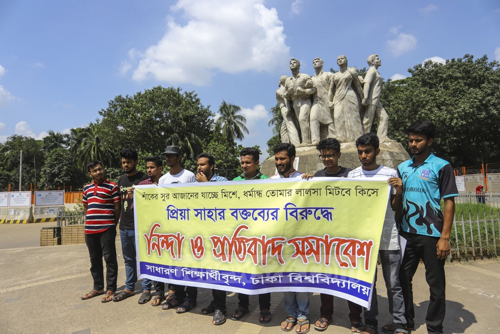 A group of Dhaka University students staged protests in front of the Raju Memorial Sculpture on Saturday, in a protest against Priya Saha's remarks to US President Donald Trump about alleged persecution of religious minorities in Bangladesh. Photo: Asif Mahmud Ove