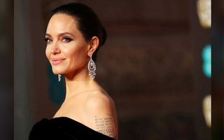 FILE PHOTO: Angelina Jolie arrives at the British Academy of Film and Television Awards (BAFTA) at the Royal Albert Hall in London, Britain, Feb 18, 2018. REUTERS