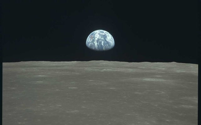 "A photo provided by NASA shows Earth as seen from the Apollo 11 lunar mission in Jul 1969. Could a ""moon shot"" for climate change cool a warming planet? Fifty years after humans first left footprints in the lunar dust, it's an enticing idea. The effort and the commitment of brainpower and money, and the glorious achievement itself, shine as an international example of what people can do when they set their minds to it. The spinoff technologies ended up affecting all of our lives. The New York Times"