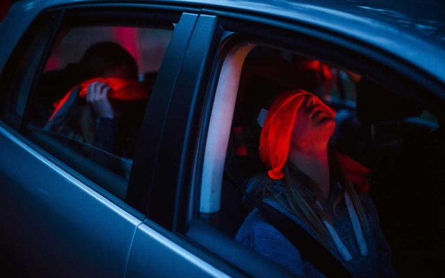 Children sit blindfolded in a car before participating in a Dutch tradition known as