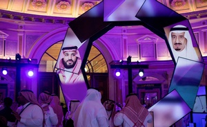 FILE -- Images of King Salman, right, and his son Crown Prince Mohammed bin Salman projected on screens during a conference at the Ritz-Carlton in Riyadh, Saudi Arabia, Jan 28, 2019. According to one of Saudi Arabia's top daily newspapers, Okaz, the government has established a committee to study the prospect of removing the guardianship requirement for women over age 18. (Tasneem Alsultan/The New York Times)