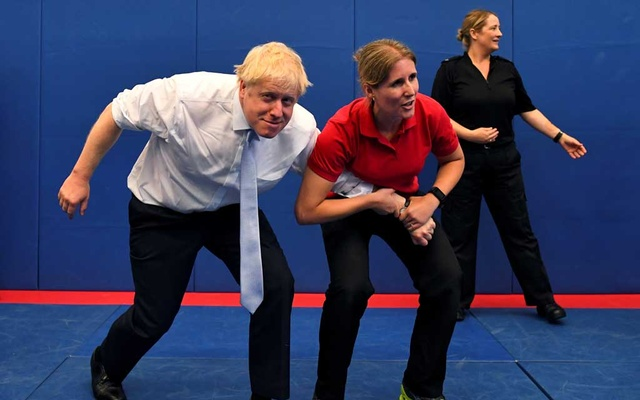 FILE PHOTO: Boris Johnson, a leadership candidate for Britain's Conservative Party, reacts as he visits the Thames Valley Police Training Centre in Reading, Britain, Jul 3, 2019. REUTERS