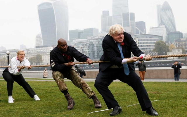 FILE PHOTO: London Mayor Boris Johnson takes part in a tug of war with members of the armed services to launch the London Poppy Day, outside City Hall, in London, Oct 27, 2015. REUTERS