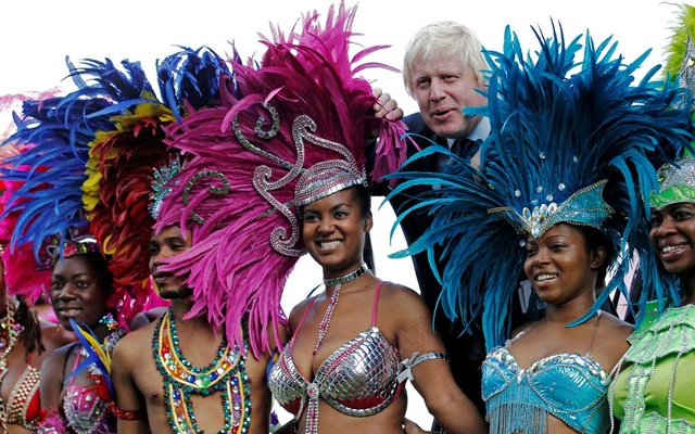 FILE PHOTO: London Mayor Boris Johnson joins dancers for a photocall to promote the Notting Hill Carnival at City Hall in London Aug 24, 2011. REUTERS