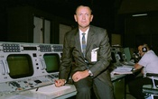 Christopher Kraft at his director console in mission control during a flight simulation in 1965. The New York Times