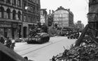 Allied tanks move into a heavily bombed Munich on Apr 29, 1945. Knowing that the American troops were closing in, residents began looting earlier that day, taking food, furniture and parts of Hitler's art collection. The New York Times