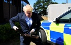 FILE PHOTO: Boris Johnson, a leadership candidate for Britain's Conservative Party, holds a battering ram as he visits the Thames Valley Police Training Centre in Reading, Britain, Jul 3, 2019. REUTERS