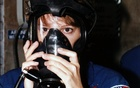 In a photo provided by NASA, astronaut Eileen Marie Collins practices using a gas mask during a terminal countdown demonstration test at Launch Pad 39A at the Kennedy Space Centre in Florida in 1997. The New York Times