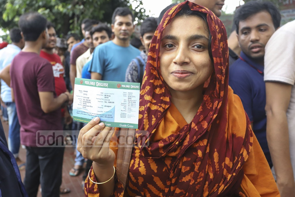 A woman purchases advance tickets at Gabtoli Bus Terminal on Friday. Photo: Asif Mahmud Ove