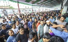 People seeking advance bus tickets ahead of Eid-ul-Azha crowd Gabtoli Bus Terminal on Friday. Photo: Asif Mahmud Ove