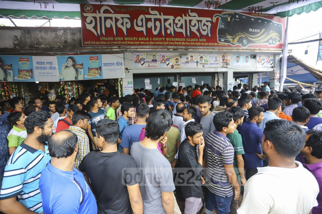 People wait for advance bus tickets at Gabtoli Bus Terminal on Friday ahead of Eid-ul-Azha holidays. Photo: Asif Mahmud Ove