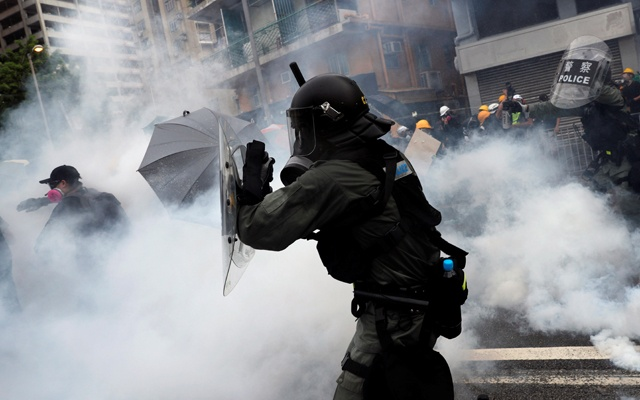 A police officer fires a tear gas at the demonstrators during a protest against the Yuen Long attacks in Yuen Long, New Territories, Hong Kong, China Jul 27, 2019. REUTERS