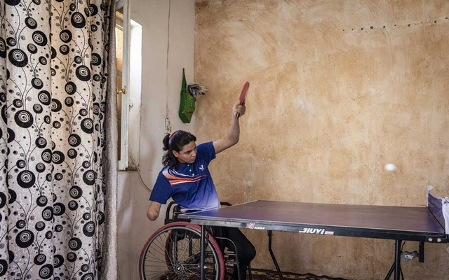 Najla Imad Lafta, a triple amputee and member of the Iraqi Paralympic Table Tennis team, trains at her home in Baqubah, Iraq, Jun 14, 2019. Najla is one of a growing number of Iraqi athletes who are competing in sports at a high level after being caught in crossfire or a bombing and losing one or more limbs. The New York Times