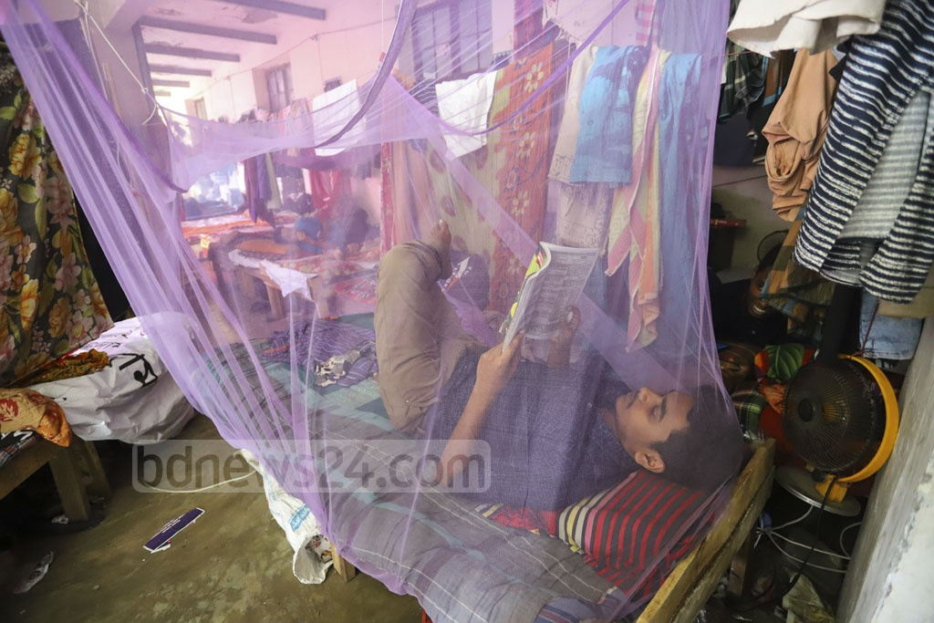 Fears of dengue have forced first-year Dhaka University students at SM Hall's veranda to keep mosquito nets hanging even during daytime. Photo: Asif Mahmud Ove