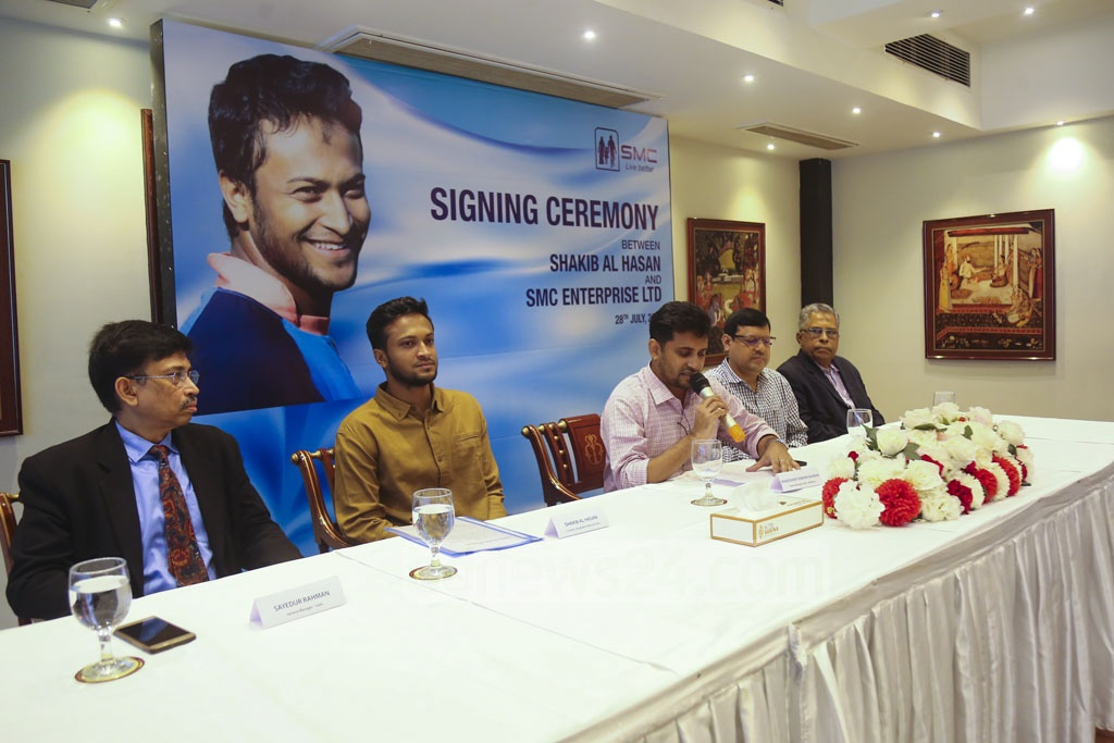 Bangladesh all-rounder Shakib Al Hasan signs a deal with Social Marketing Company or SMC as a brand ambassador for two products at a hotel in Dhaka on Sunday. Photo: Mahmud Zaman Ovi