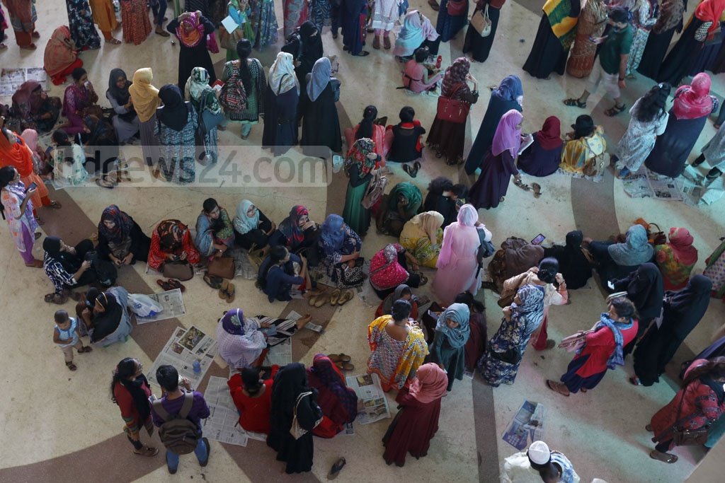 Women get some rest at the crowded Kamalapur Railway Station in the capital on Monday, the first day of advance Eid train ticket sale. Photo: Mostafigur Rahman