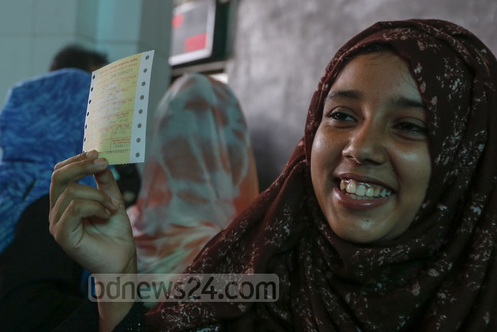 The long wait is over—her smile says it all. This woman has secured tickets to her desired destination for Eid. This photo was taken at Dhaka's Kamalapur Railway Station on Monday. Photo: Mostafigur Rahman