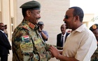 FILE PHOTO: Ethiopian Prime Minister Abiy Ahmed meets Sudan's Head Of Transitional Military Council, Lieutenant General Abdel Fattah Al-Burhan Abdelrahman to mediate in the political crisis that has followed the overthrow of President Omar al-Bashir at the airport in Khartoum, Sudan Jun 7, 2019. REUTERS/Mohamed Nureldin Abdallah/File Photo