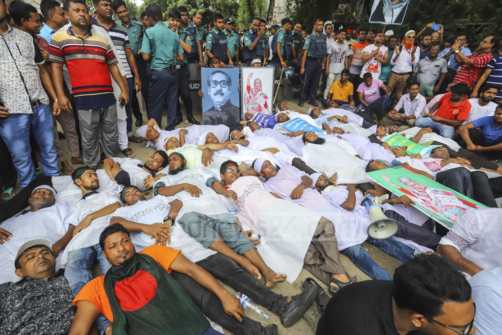 Several members of Bangladesh Municipality Service Association wore white pieces of cloth resembling shrouds during a sit-in protest outside the Secretariat in Dhaka on Wednesday over different demands, including payment of due salary. Photo: Asif Mahmud Ove
