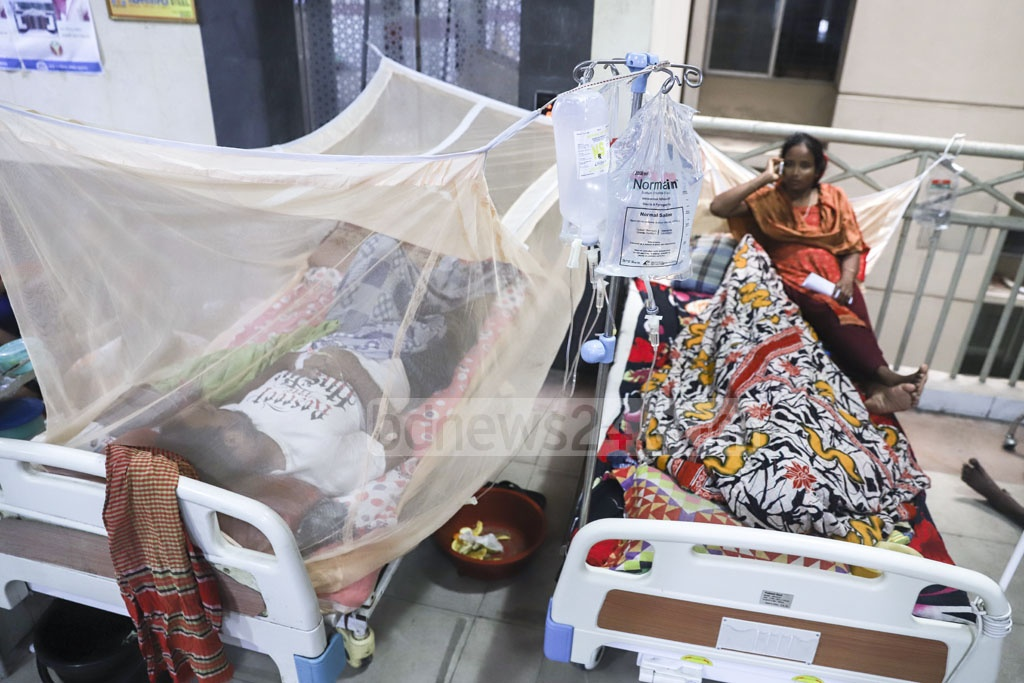 A lack of space means dengue patients are kept even on the floor in front of the lift of Mugda General Hospital amid an outbreak of the viral disease. Photo: Abdullah Al Momin