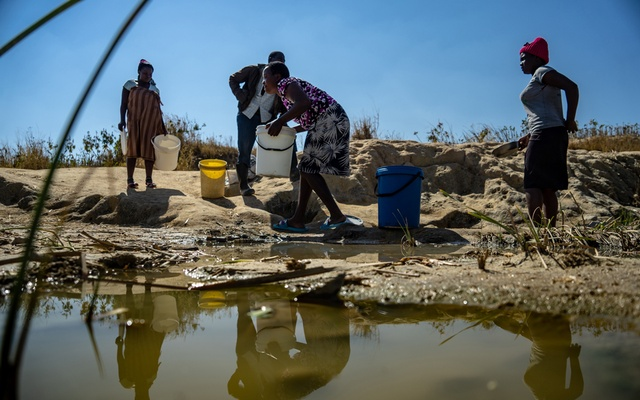 Residents collect water from a spring outside Epworth, in Harare, Zimbabwe, July 21, 2019. The New York Times