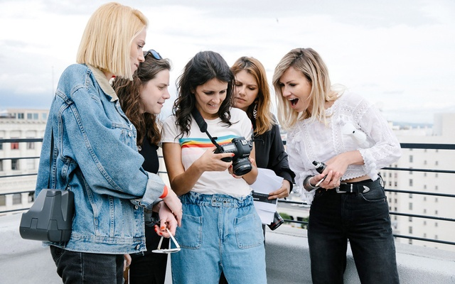 Playboy's photo editor, Anna Wilson, and creative director, Erica Loewy, review photos with photographer Ana Dias during a shoot in Los Angeles on Mar 5, 2019. It is the first time in Playboy's history that both its creative director and photo editor have been women.