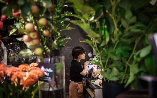 "Sanae Hanaoka at the florist shop where she works once a week. ""I want to rely on my own strength,"" she said.CreditAndrea DiCenzo for The New York Time"