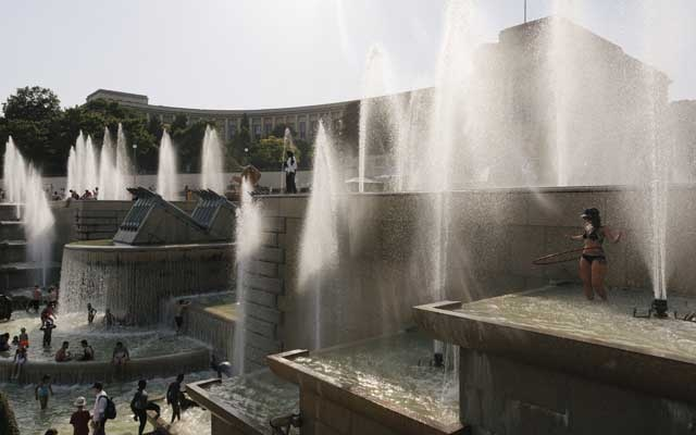 Caption: FILE PHOTO: People cool off in the Trocadéro fountains near the Eiffel Tower in Paris on Thursday, Jul 25, 2019. European climate researchers said on Aug 5, 2019, that last month was the hottest July—and thus the hottest month—ever recorded, slightly eclipsing the previous record-holder, Jul 2016. The New York Times