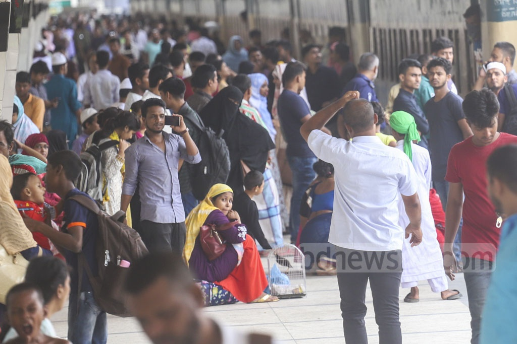 Homebound people waiting for a delayed Kishoreganj-bound train at Kamalapur Railway Station on Wednesday. Photo: Abdullah Al Momin