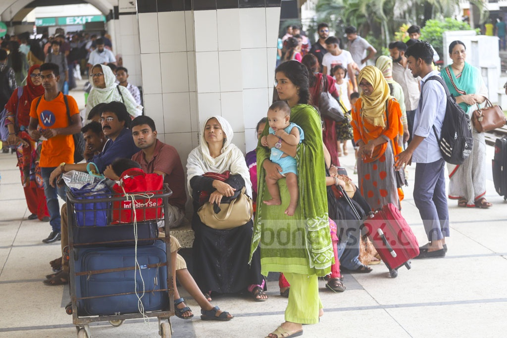 Homebound people waiting for a train at Kamalapur Railway Station on Wednesday. Photo: Abdullah Al Momin