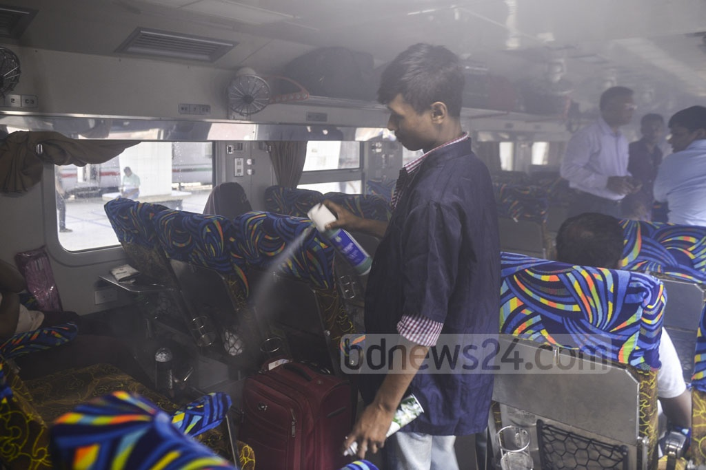 The dengue epidemic has also hit Eid train journey. A railway official spraying aerosol inside the Banalata Express train before it departed Kamalapur Railway Station on Wednesday. Photo: Abdullah Al Momin
