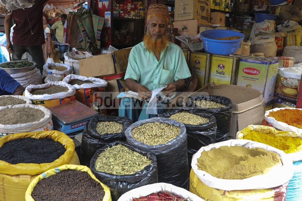 A local makeshift spice shop has been thrown up at the 'Ghior Haat' in Manikganj before the Eid-ul-Azha