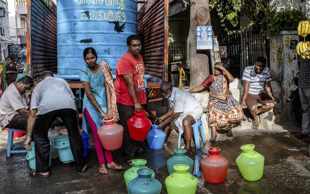File Photo: Residents collect water delivered by a tanker in the Royapettah district of Chennai, India, Jun 24, 2019. The city's four major water reservoirs had virtually run dry by summer. Around the world, 17 countries are currently facing extremely high water stress. Climate change is making the problem worse. The New York Times