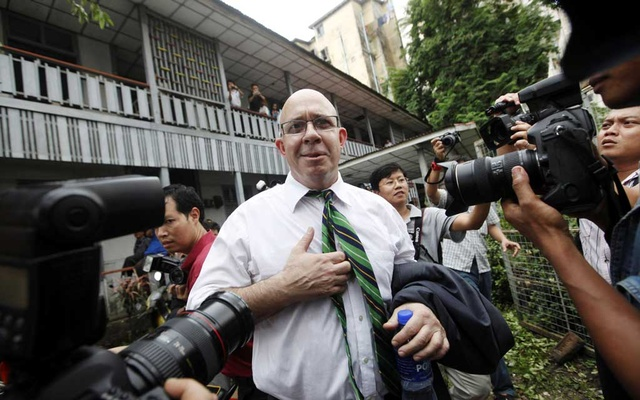 File Photo: Australian journalist Ross Dunkley talks to reporters after his court hearing at Kamaryut township in Yangon Jun 30, 2011. REUTERS