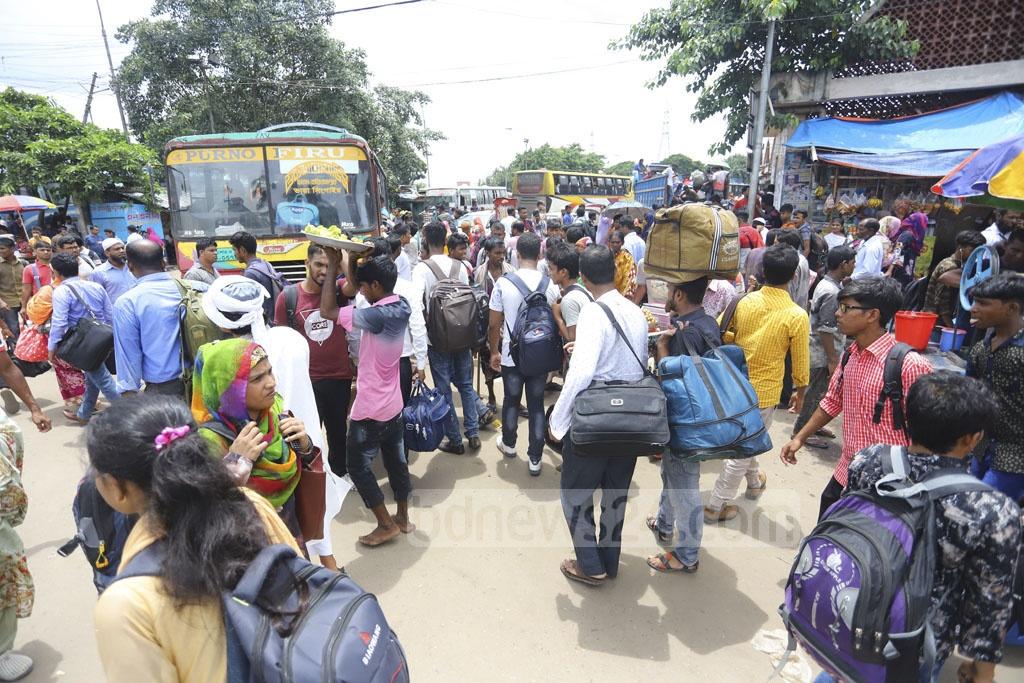 Holidaymakers flock to Gabtoli Bus Terminal two days before Eid-ul-Azha on Friday. Photo: Asif Mahmud Ove