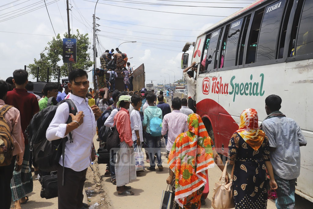Many holidaymakers have rented trucks to leave Dhaka for Eid-ul-Azha celebration at their home towns or villages. This photo was clicked near Aminbazar Bridge in Dhaka. Photo: Asif Mahmud Ove