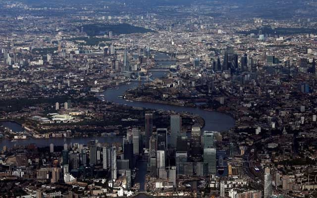 FILE PHOTO: Canary Wharf and the City of London financial district are seen from an aerial view in London, Britain, August 8, 2019.  Reuters