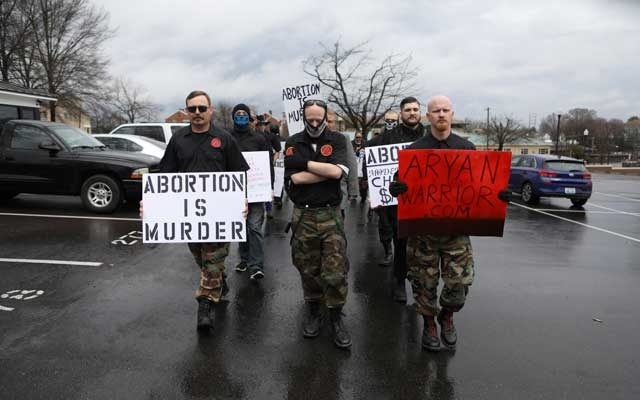 Members of the ShieldWall Network, a white nationalist group, march to a rally opposing legal abortion and supporting gun rights at the state capitol in Little Rock, Arkansas, US, March 9, 2019. Picture taken March 9, 2019. REUTERS