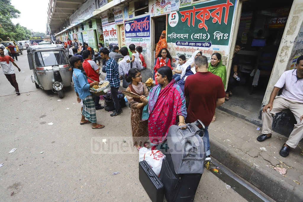 Passengers wait for transport at Gabtoli Bus Terminal amid pressure of Eid holidaymakers. Photo: Asif Mahmud Ove