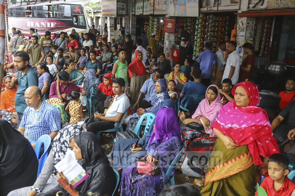 Some Eid holidaymakers waiting for bus at the Hanif Paribahan counter in Dhaka's Gabtoli had been waiting since Friday night. This photo was clicked on Saturday. Photo: Asif Mahmud Ove