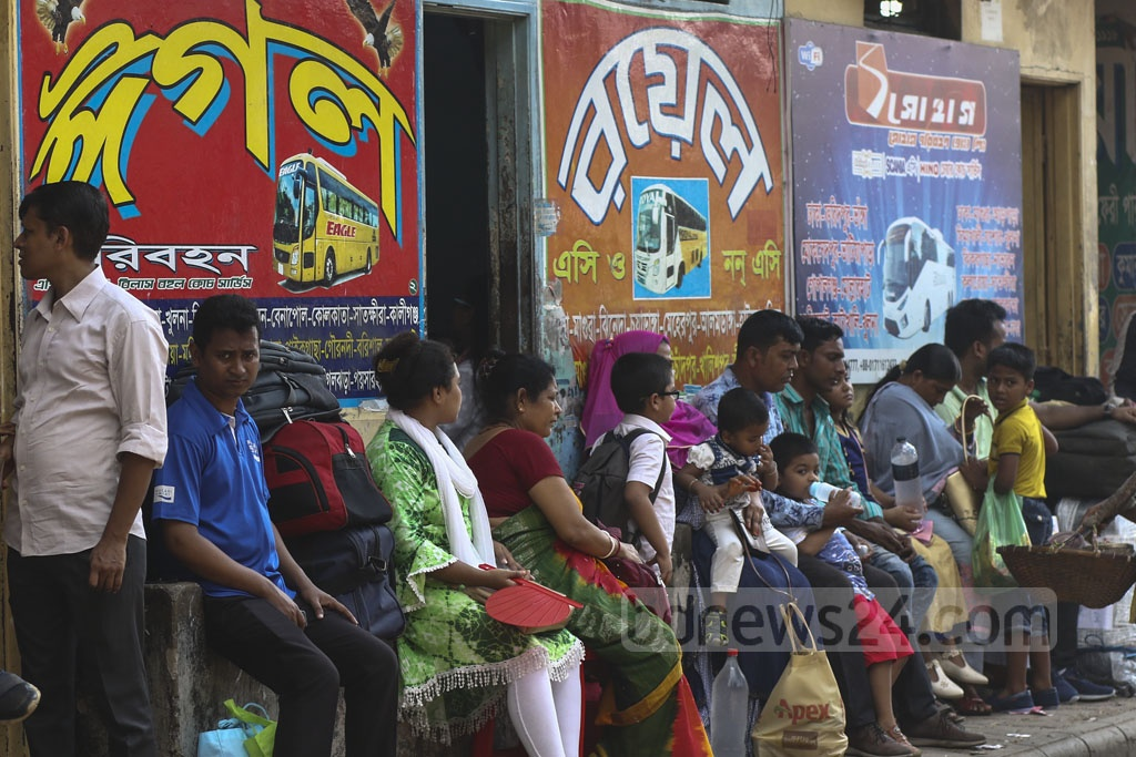 Eid travellers waited for hours on end for transport at Gabtoli Bus Terminal in Dhaka on the eve of Eid-ul-Azha though the pressure was less on Sunday. Photo: Mahmud Zaman Ovi