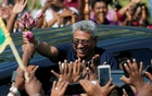 Sri Lanka's former defense secretary Gotabaya Rajapaksa greets his supporters after his return from the United States, in Katunayake, Sri Lanka Apr 12, 2019. REUTERS/Dinuka Liyanawatte/Files